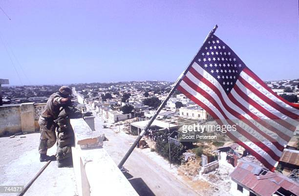 Marine stands guard atop a building March 3, 1993 in Mogadishu, Somalia. The U.S. Has been the main pillar in an international peacekeeping effort...