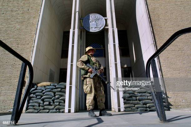 Marine stands guard in front of the US embassy December 21, 2001 in Kabul, Afghanistan. The embassy opened on December 17, 2001 for the first time...