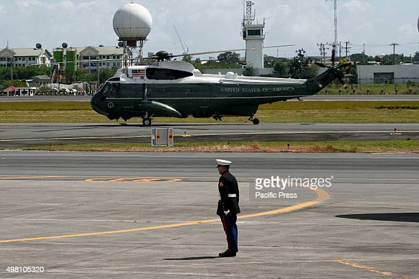 S Marine stands in attention as Marine One taxis on the runway US president Barack Obama departs from the Villamor Airbase in Pasay city after...