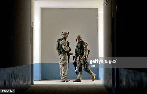 S Marine stands in the hallway of a newly refurbished school while patrolling on September 14 2004 in the Iraqi Holy city of Najaf Weeks of battles...