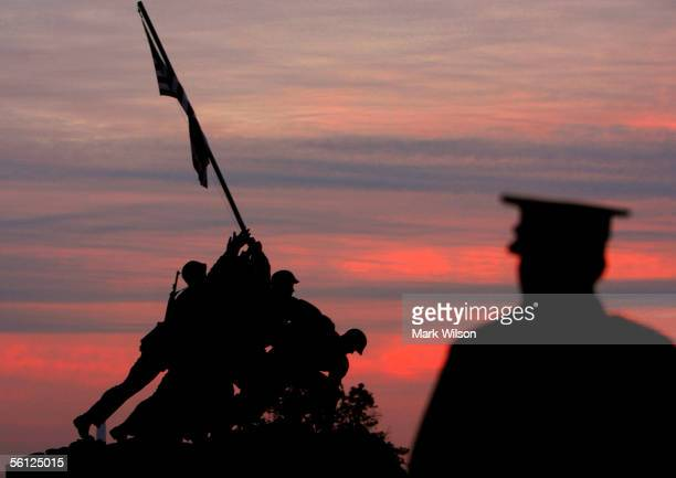 S Marine stands near the Iwo Jima Memorial as the early morning sun begins to rise November 9 2005 in Arlington Virginia On November 19 the US...