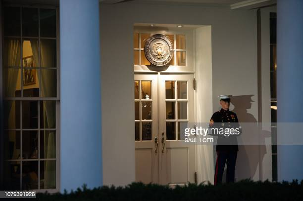 Marine stands outside the West Wing of the White House in Washington DC January 8 ahead of an address on border security and the government shutdown...