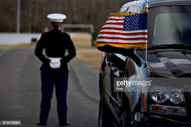 A US Marine stands past an American flag before US President Donald Trump lands on Marine One at Paul Hencken Soccer Fields before Trump visits the...