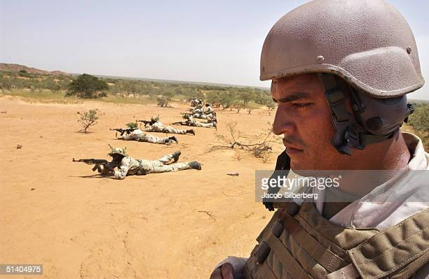 Marine supervises a battalion of Nigerien soldiers as they fire on a target during a training exercise September 22 2004 in Samara Niger Through the...