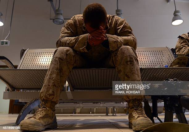 Marine takes a rest as British and US troops prepare to withdraw from the Camp BastionLeatherneck complex at Lashkar Gah in Helmand province on...