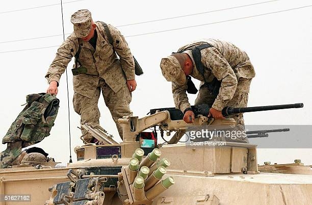 Marine tankers of the 1st Marine Expeditionary Force prepare their M1A1 tanks for an expected military offensive against Iraqi insurgents in the city...