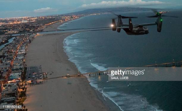 Marine V22 Osprey in support of the visit of US President Donald Trump flies near Venice Beach as Trump travels to Trump National Golf Club Los...