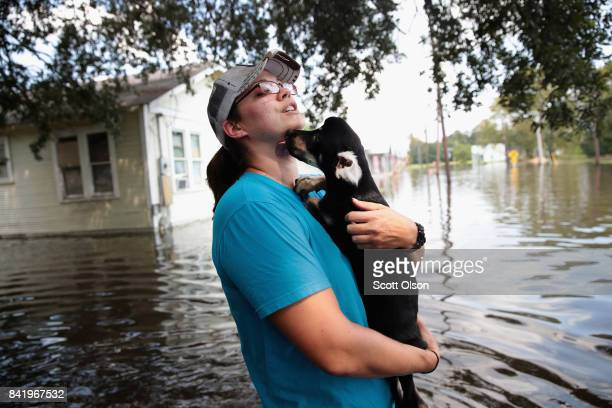 Marine veteran Megan Lowry with the Wounded Veterans of Oklahoma helps to rescue a puppy from a flooded home after torrential rains pounded Southeast...