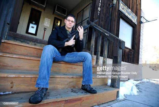 US Marine veteran Savant Suykerbuyk holds his unloaded Stag Arms Model 2 AR15 outside of Boulder Gunsport on 14th Street on Wednesday Feb 27 in...
