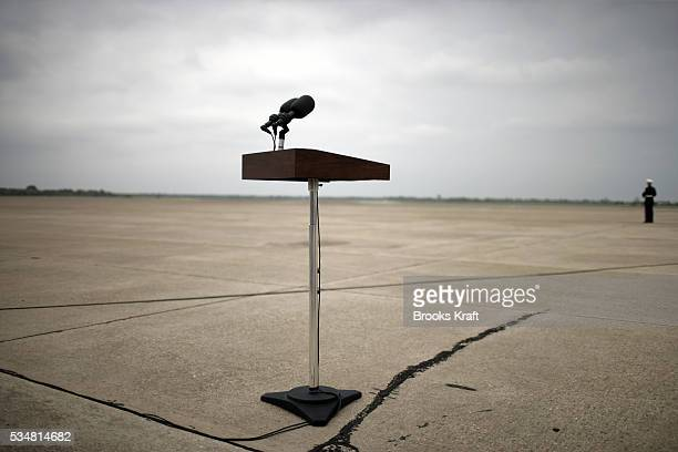 A Marine waits for President Bush to arrive at TSTC Airport in Waco where he was to make a statement to the press