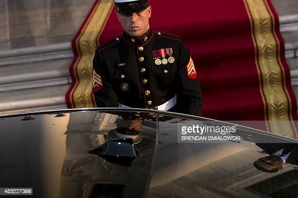 Marine waits to open the door of a limo at the White House for a group dinner during the US Africa Leaders Summit August 5 2014 in Washington DC AFP...