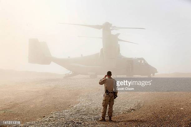 S Marine watches as an Osprey carrying US Secretary of Defense Leon Panetta arrives March 14 2012 at Forward Operating Base Shukvani Afghanistan...
