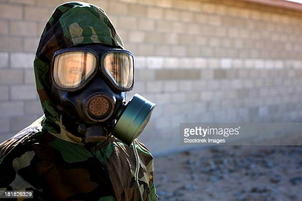 A Marine wearing a gas mask after completion of the confidence chamber.