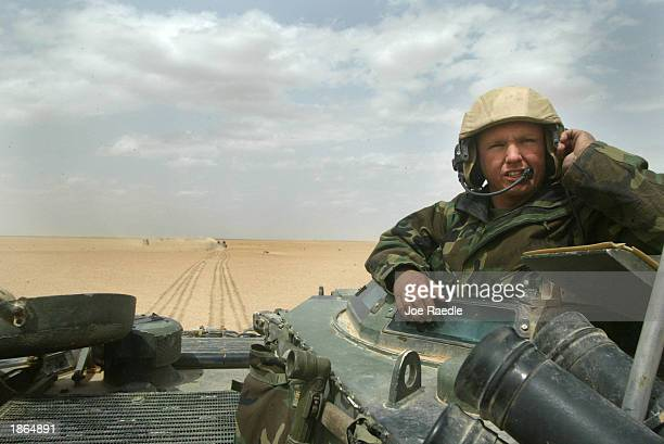 S Marine William Schaefer from Colombia South Carolina of Task Force Tarawa commands an armored assault vehicle through the Iraqi countryside March...