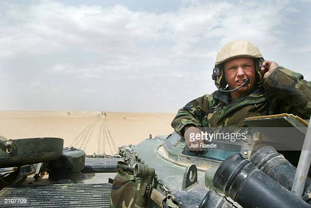 US Marine William Schaefer from Colombia South Carolina of Task Force Tarawa commands an armored assault vehicle through the Iraqi countryside March...