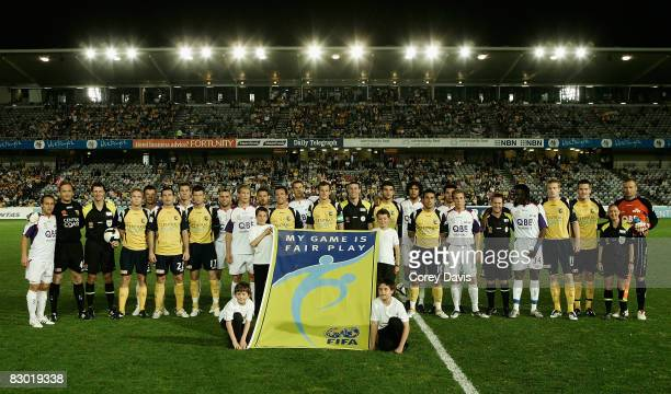 Mariner and Glory players poses for a FIFA Fair play photo ahead of the round six A-League match between the Central Coast Marinersand the Perth...