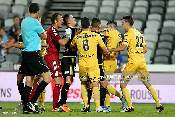 Mariners and Phoenix players during an altercation during the round 13 ALeague match between the Central Coast Mariners and the Wellington Phoenix at...