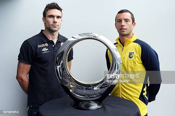 Mariners captain John Hutchinson and Wanderers captain Michael Beauchamp pose in front of the Hyundai ALeague Champions Trophy during the ALeague...