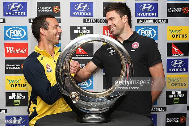 Mariners captain John Hutchinson and Wanderers captain Michael Beauchamp shake hands in front of the Hyundai ALeague Champions Trophy during the...