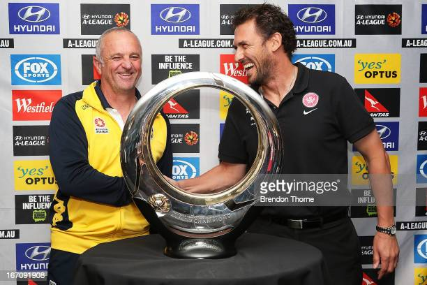Mariners coach Graham Arnold and Wanderers coach Tony Popovic shake hands in front of the Hyundai ALeague Champions Trophy during the ALeague 2013...