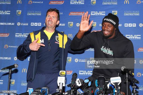 Mariners coach Mike Mulvey and Usain Bolt at the press conference during Usain Bolt's first training session with the Central Coast Mariners ALeague...
