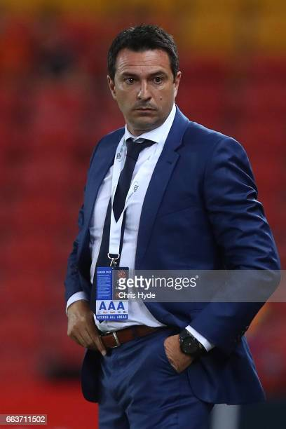 Mariners coach Paul Okon looks on during the round 25 ALeague match between the Brisbane Roar and the Central Coast Mariners at Suncorp Stadium on...