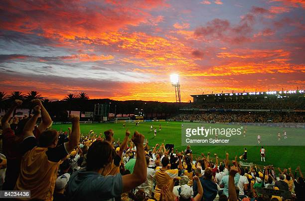 Mariners fans celebrate a goal during the round 19 A-League match between the Central Coast Mariners and the Queensland Roar at Bluetongue Stadium on...
