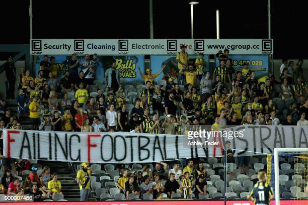Mariners fans display a message on a sign during the round 13 ALeague match between the Central Coast Mariners and the Wellington Phoenix at Central...