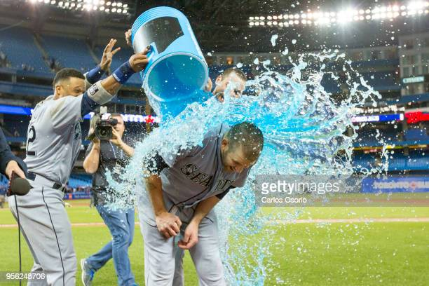 TORONTO ON MAY 8 Mariners pitcher James Paxton is showered with a sports drink by Robinson Cano and Mike Zunino after his complete game no hitter as...