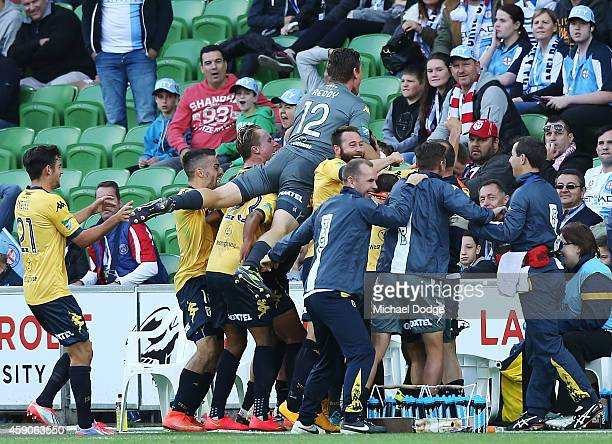 Mariners players celebrate a goal by John Hutchinson that drew the game during the round six ALeague match between Melbourne City FC and the Central...