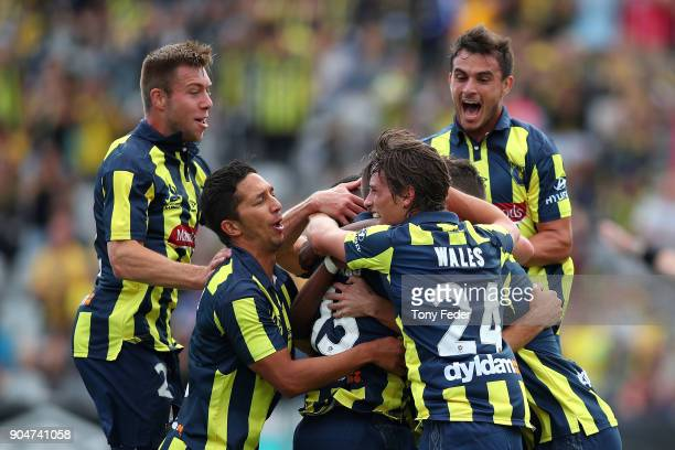 Mariners players celebrate a goal during the round 16 ALeague match between the Central Coast Mariners and Melbourne City at Central Coast Stadium on...