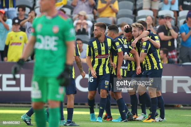 Mariners players celebrate a goal during the round nine ALeague match between the Central Coast Mariners and Perth Glory at Central Coast Stadium on...