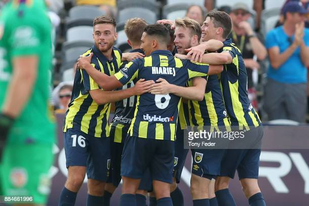 Mariners players celebrate a goal during the round nine A-League match between the Central Coast Mariners and Perth Glory at Central Coast Stadium on...