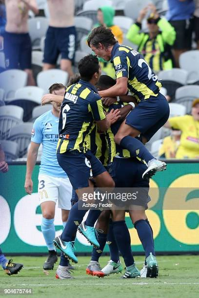 Mariners players celebrate a goal from Alan Baro during the round 16 ALeague match between the Central Coast Mariners and Melbourne City at Central...