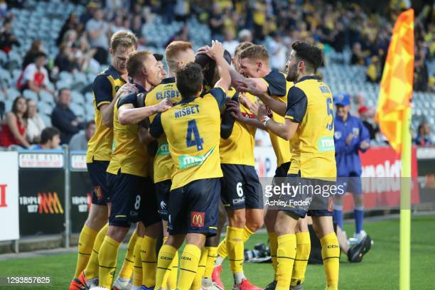 Mariners players celebrate a goal from Alou Kuol of the Mariners during the A-League match between the Central Coast Mariners and the Newcastle Jets...