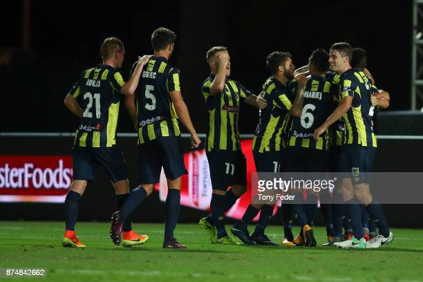 Mariners players celebrate after scoring a penalty during the round seven A-League match between the Central Coast Mariners and Adelaide United at...
