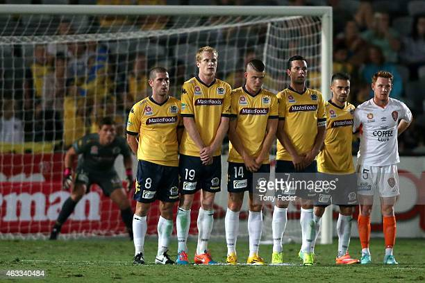Mariners players line up to defend a free kick during the round 17 ALeague match between the Central Coast Mariners and the Brisbane Roar at Central...