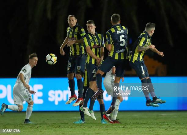 Mariners players stop a free kick during the round 21 ALeague match between the Central Coast Mariners and the Wellington Phoenix at Central Coast...