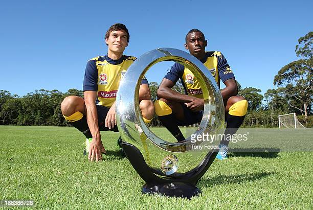 Mariners players Trent Sainsbury and Bernie Ibini pose with the Hyundai ALeague championship trophy during the Central Coast Mariners ALeague Semi...