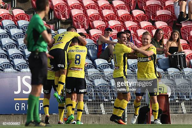 Mariners team mates celebrate a goal during the round seven ALeague match between the Newcastle Jets and the Central Coast Mariners at Hunter Stadium...