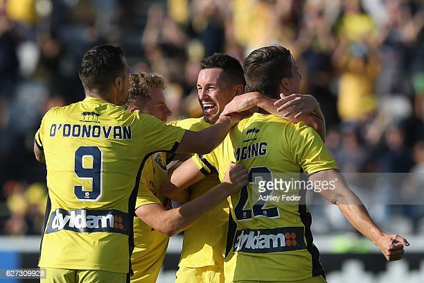 Mariners team mates celebrate a goal from Blake Powell during the round nine A-League match between Central Coast Mariners and the Western Sydney...