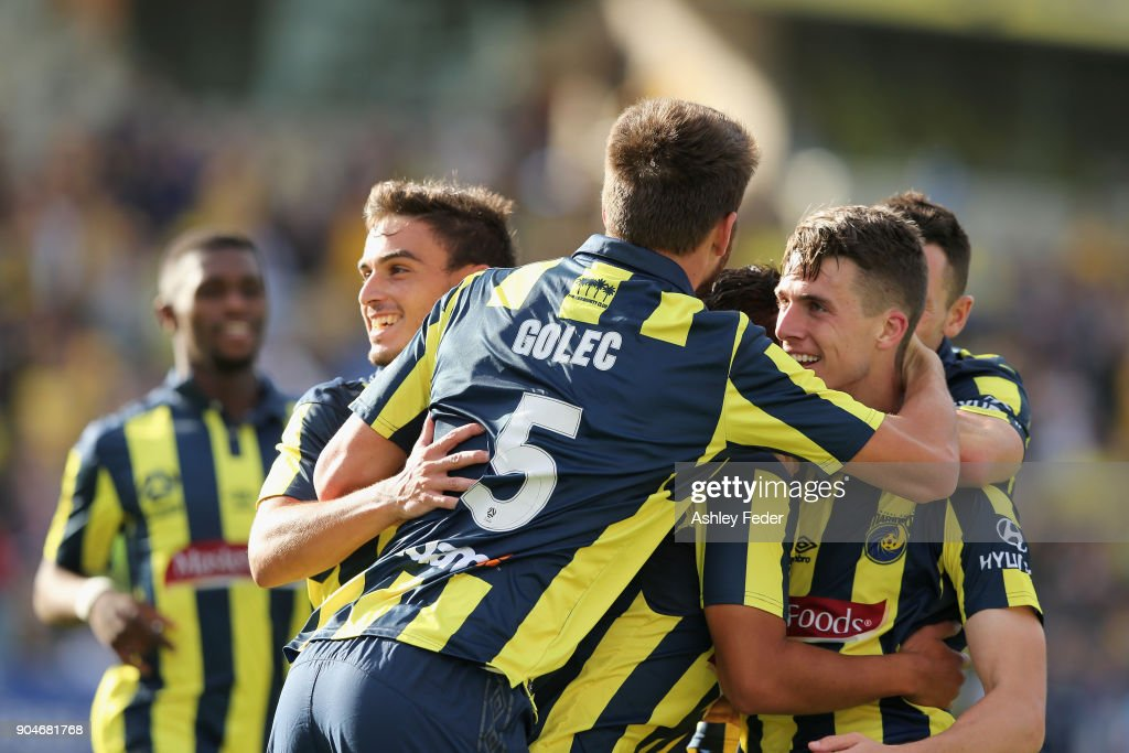 Mariners team mates celebrate a goal from Jake McGing of the Mariners during the round 16 A-League match between the Central Coast Mariners and Melbourne City at Central Coast Stadium on January 14, 2018 in Gosford, Australia.