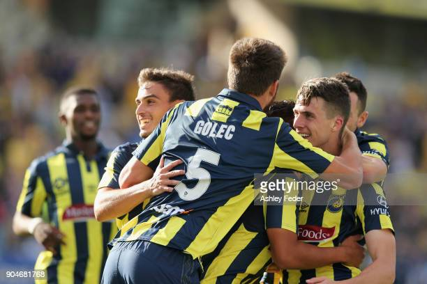 Mariners team mates celebrate a goal from Jake McGing of the Mariners during the round 16 ALeague match between the Central Coast Mariners and...