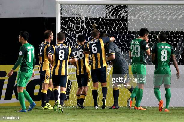 Mariners teammates celebrate Liam Reddy's penalty save with Beijing teammates looking dejected during the Asian Champions League match between the...