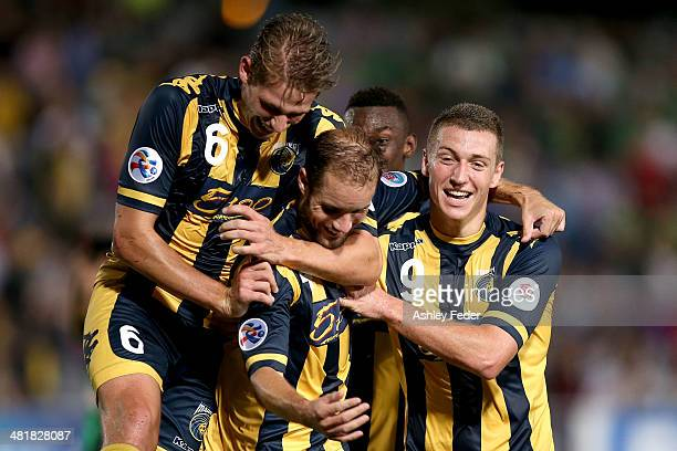 Mariners teammates Nick Fitzgerald Mitchell Duke Marcel Siep and Bernie Ibini celebrate a goal by Marcel Siep of the Mariners during the Asian...