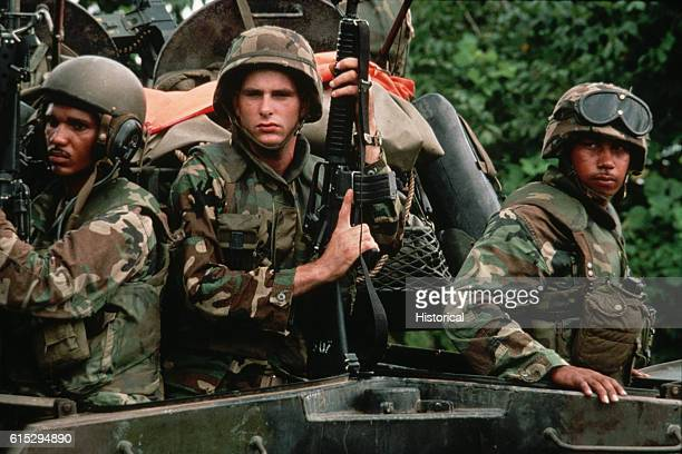 Marines aboard a LAV25 light armored vehicle keep a sharp watch around their vehicle after their patrol was stopped by supporters of General Manuel...