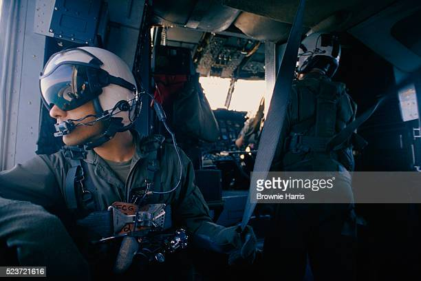 marines aboard helicopter - us marine corps stock pictures, royalty-free photos & images