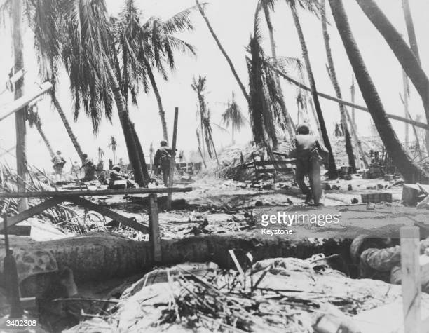 US marines advance between blasted tropical palms on Tarawa in the Gilbert Islands in early stages of fighting on the Japaneseheld atoll During the...