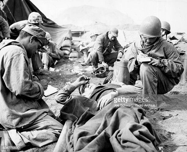 Marines Aid Wounded Comrade on Iwo Jima