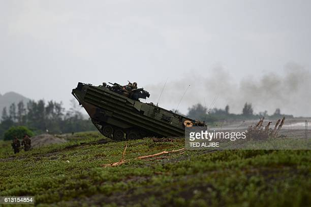 A US marines Amphibious Assault vehicle manuevers during the PhilippinesUS amphibious landing exercise at a naval training base facing South China...